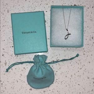 "Tiffany & Co. ""J"" pendant by Elsa Peretti."